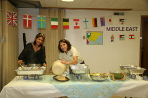 Rula Hanania and Aline Hamati Haddad serve Middle Eastern cuisine they personally prepared at a past UPC Ethnic Food Fair.